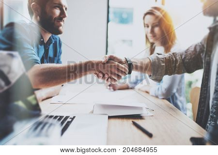Business male partnership handshake concept.Photo two coworkers handshaking process.Successful deal after great meeting.Horizontal, blurred background