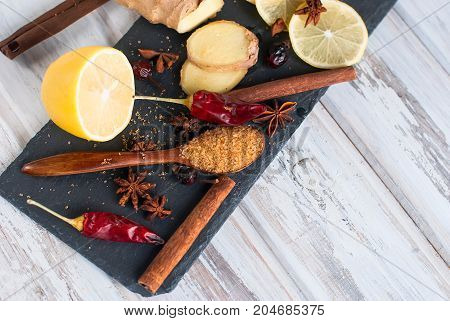 Lemon, Ginger, Sugar And Spices - Ingredients For A Spicy Warming Tea