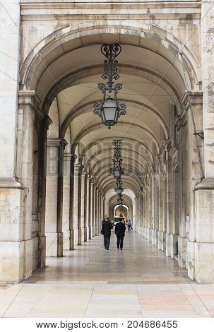 Two business man walking back to the office through beautiful old town building in Lisbon, Portugal. Portuguese capital offer many different jobs for high rated companies with comparable salaries