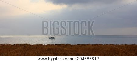 Sailing Boat On A Blue Sea And Sky Background
