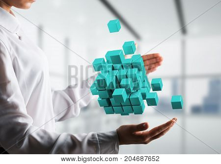 Cropped image of business woman hands holding multiple light blue cubes in hands. Mixed media.