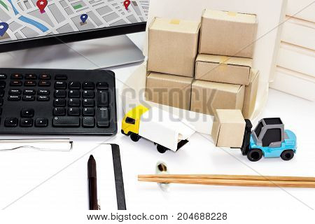 Food Delivery : Freight transportation or packages shipment in boxes and shipping logistics and business food Delivery concept with computer and blank clipping board.