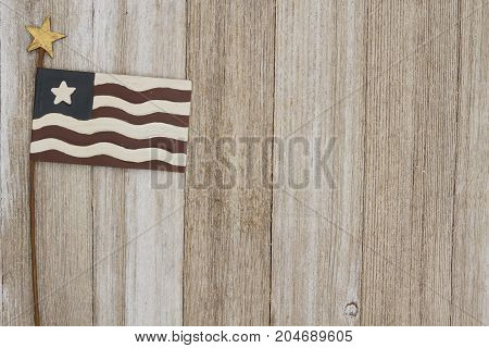Retro patriotic USA background USA patriotic old metal flag on a weathered wood background with copy space