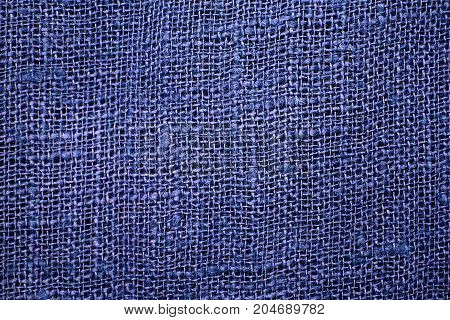 Blue linen cloth close-up background. Fabric teak canvas texture