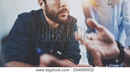 Account manager working process.Young coworkers work with new startup project in office.Horizontal.Blurred background.Cropped
