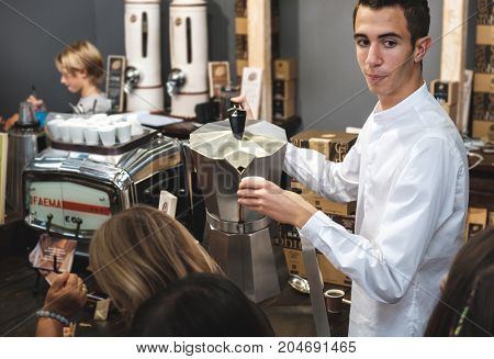 Bologna Italy 10 Sep 2017: traditional Caffe Italiano at the BAR a young italian waiter
