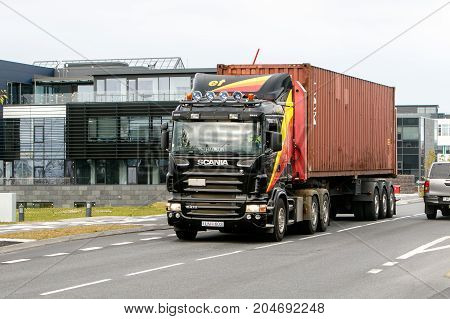 Reykjavik Iceland August 24 2017: Scania truck is transporting a container in the streets of Reyjkjavik.
