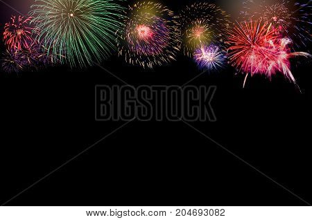 Colorful Fireworks on black background with copy space at the bottom for text insertion or decoration holiday celebration concept