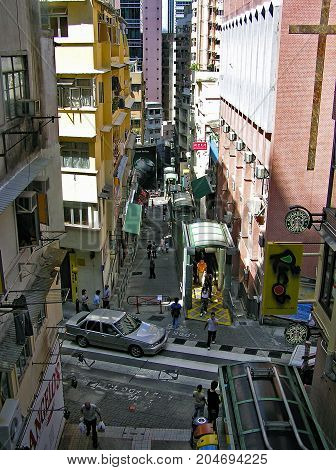 Mid-Levels, Hong Kong - March 25, 2003: The Central - Mid-Levels Escalator connects the districts of Central and Mid-Levels on Hong Kong island.