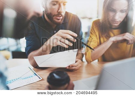 Teamwork concept.Business team sitting at meeting room and making conversations.Horizontal.Blurred background