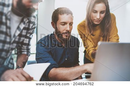 Teamwork business concept.Young Coworkers sitting at meeting room and using laptop.Horizontal.Blurred background