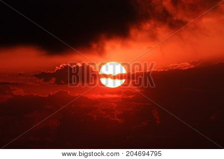Bloody red sunset with  dramatical black clouds