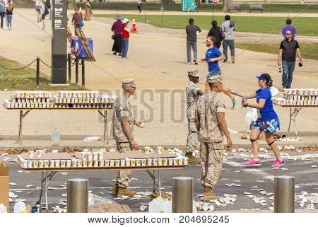 Washington D.C USA october 30 2016: Marines offering refreshment for Runners competing in the Marine Corps Marathon in Washington D.C