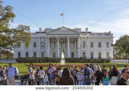 Washington D.C. USA october 29 2016: Tourists in front of the White House. It is the official residence and principal workplace of the President of the United States.