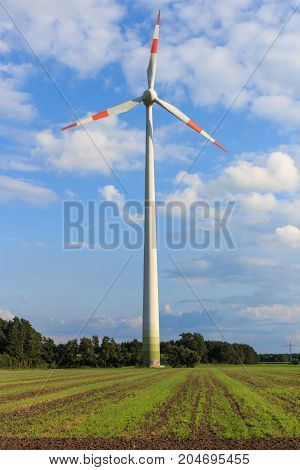 Wind turbine in the field somewhere in Lower Saxony, Germany- a renewable energy source