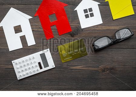 buy house online set with paper figures on office desk wooden background top view mock-up