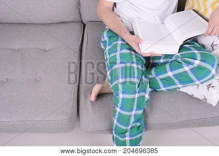 Man Reading A Book.