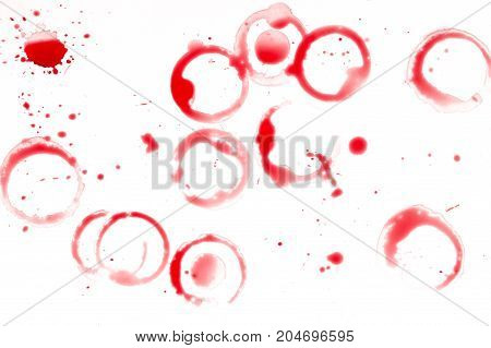Spots of red wine on the white table