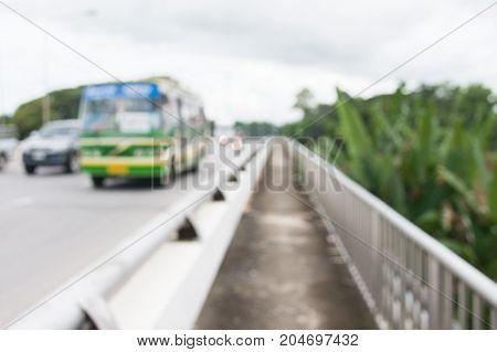 blurred backgroud of public bus and car crossing bridge road higway in thailand