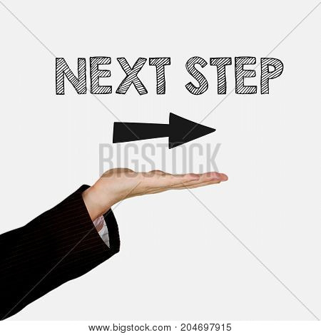 Woman showing open hand palm with text Next Step, isolated on background. Information concept.