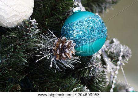 many beautiful decorations on the Christmas tree