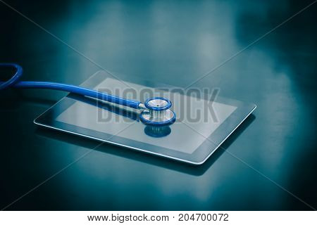 Stethoscope and tablet on table still life style concept consulting treat patients.