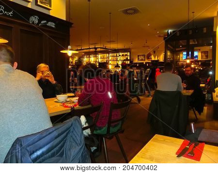 Munich, Germany - May 01, 2017: The people resting at Traditional Bavarian Tracht in restaurant or pub Stubn with beer at Munich, Germany on May 01, 2017