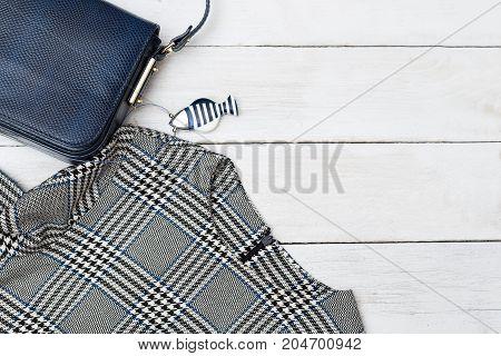 Fashion accessories with dark blue handbag. Copy space