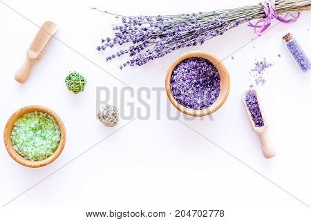 organic cosmetic set with lavender herbs and sea salt in bottle on white table background flat lay mockup