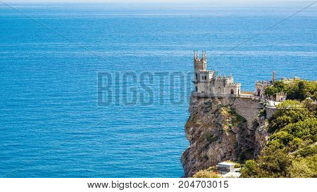 The castle Swallow's Nest on the rock over the Black Sea in Crimea, Russia. This castle is a symbol of Crimea. 16:9 widescreen.