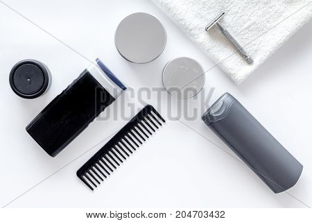 Cosmetics for men on white background top view.