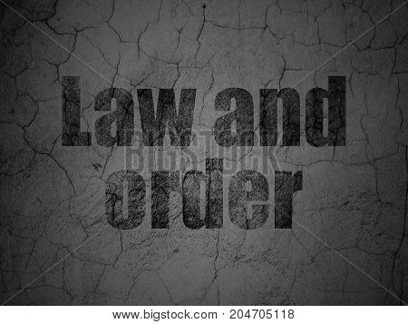 Law concept: Black Law And Order on grunge textured concrete wall background