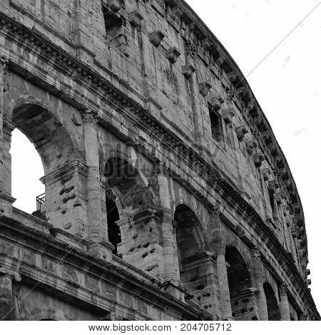 Closeup Portrait Of Coliseum Building Old Wall With Arch In Rome, Italy. Black And White