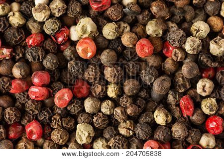three kind of peppercorns close up background .