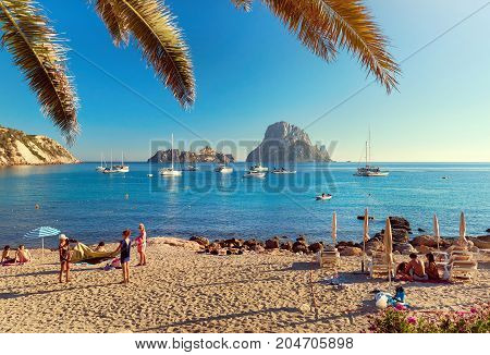 Ibiza Island, Spain - June 12, 2017: Cala d'Hort beach. Cala d'Hort in summer is extremely popular beach have a fantastic view of the mysterious island of Es Vedra. Ibiza Island Balearic Islands. Spain