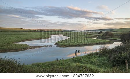 Beautiful Dawn Landscape Over English Countryside With River Slowly Flowing Through Fields