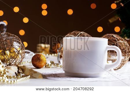 Cup of Coffee and a Christmas decoration. Holidays background. with cup of coffee on wooden table.