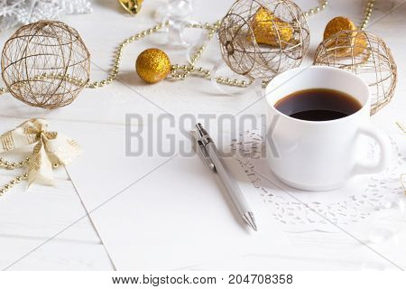 Cup of Coffee and a Christmas decoration. Holidays background. with cup of coffee on wooden table. Copy space for wishlist or shedule