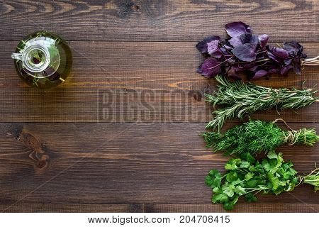 greenery with natural oil for home food cooking on wooden kitchen table background top view mock-up