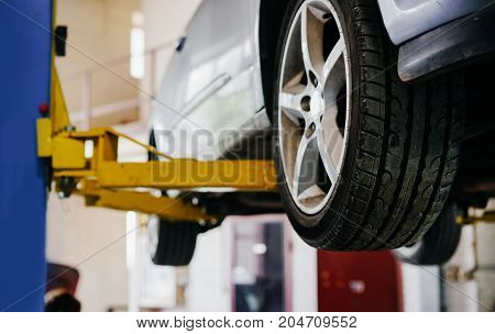 The vehicle is raised for service replacement of parts oil and seasonal and yearly maintenance.