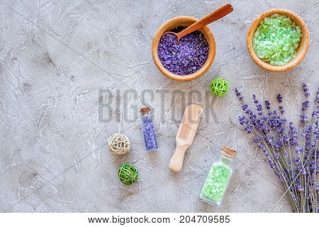 home made spa with lavender herbs cosmetic salt for bath on stone desk background top view mock-up