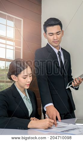 image of Businessman And Businesswoman Meeting In Office