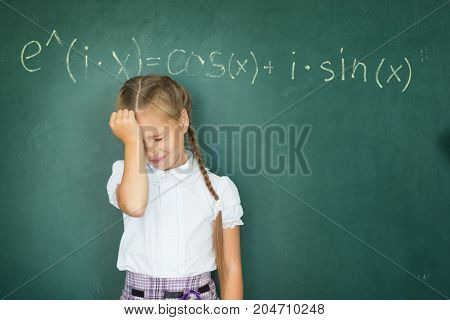 Child Girl Schoolgirl And Compound Formula On The Chalkboard. Complex School Program Does Not Match