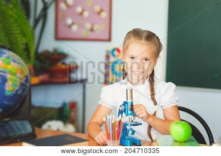 Young Girl Making Science Chemistry Experiments In School Laboratory. Education Concept
