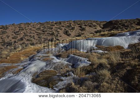 Cascade of frozen water on a hillside in Lauca National Park on the altiplano of northern Chile