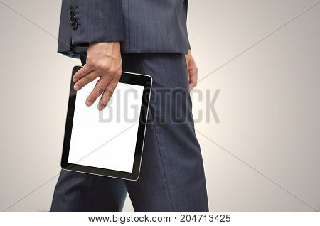 Business man holding tablet computer with blank screen in his hand.
