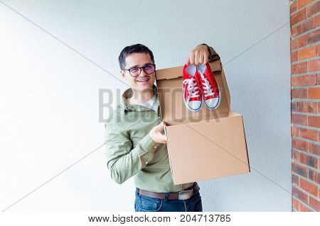 Handsome Man With Moving Boxes And Red Gumshoes