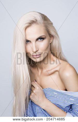 Beautiful healthy blonde hair, portrait indoor shot