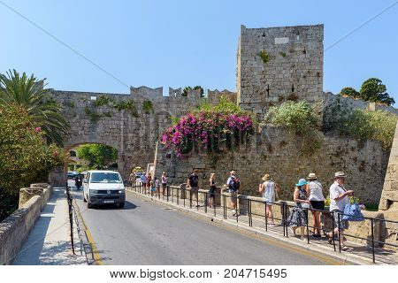 RHODES,GREECE - AUGUST 2017: Tourists are walking to Rhodes town old medieval fortress.