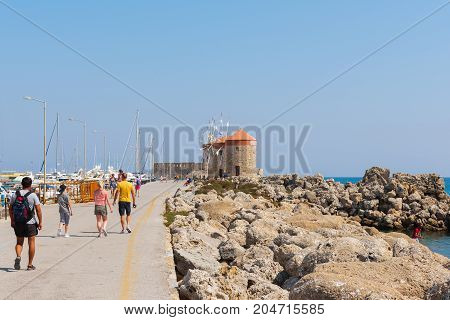 RHODES, GREECE - AUGUST 2017: People are walking at promenade of Rhodes town